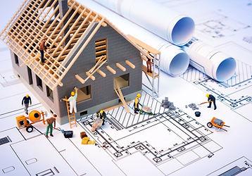 Cartoon house being built with blueprint