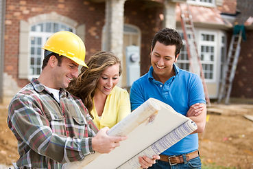 Man and woman looking at plans with man wearing a construction hat
