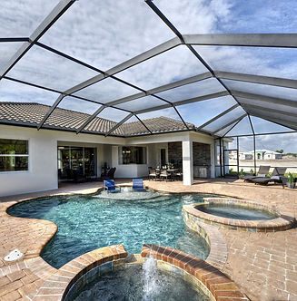 Screened in enclosure with pool, spa, fountain, and pavered patio
