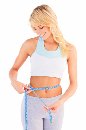 Woman measuring waist with measurng tape