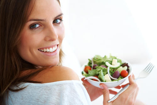 Woman smiling with salad