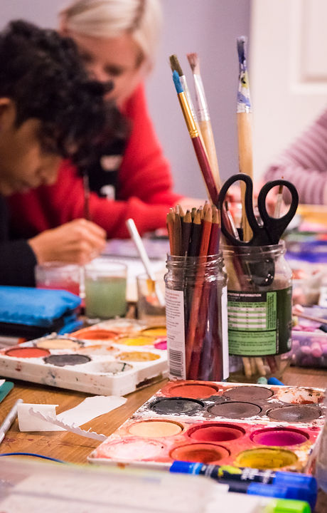 Art materials in foreground