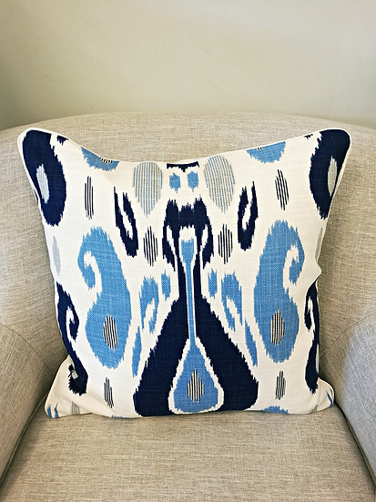 Ikat pattern throw pillow in multiple shades of blue and navy