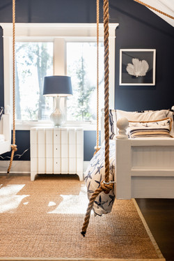 Twin swing beds hang from ropes with custom bedding by Aubergine Home Collection