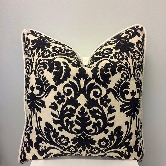 22 inch square throw pillow in a black and ivory floral pattern
