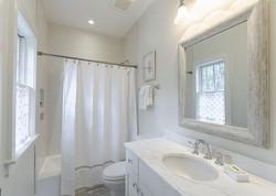 Modern beach house's guest bathroom in neutral tones