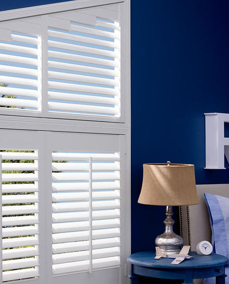 Hunter Douglas Palm Beach Plantation shutters in angled bedroom window