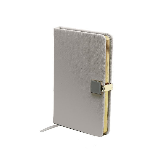 Small lined notebook in a faux leather binding with magnetic clasp
