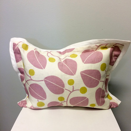 Printed throw pillow in a mauve and chartreuse botanical pattern