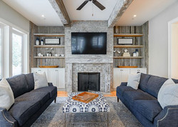 Bookshelves in family living room decorated with modern beach house decor pieces