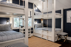 Nautical bunk room with blue and white bedding by Aubergine Home Collection