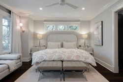 Bedroom with custom bedding and furnishings created by Aubergine Home Collection in Kiawah Island SC