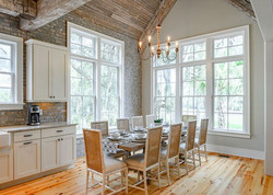 Eat in kitchen with a 10 seat dining table in a modern beach house