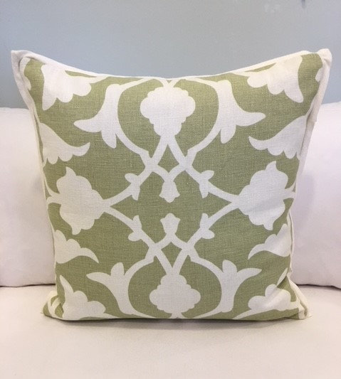 Green and ivory modern botanical throw pillow with an ivory welt edge