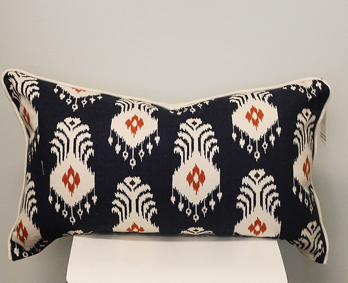 Decorative lumbar throw pillow in a navy blue ikat medallion print