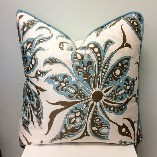 Accent throw pillow with a blue and brown Polynesian stylized flower pattern