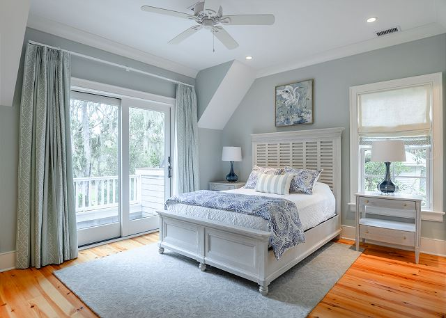 Bedroom in modern beach house on Kiawah Island with pieces by Aubergine Home Collection