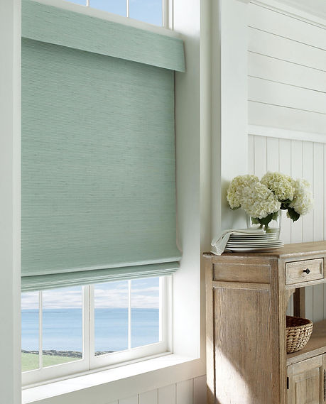 Hunter Douglas Provenance Woven Wood shades in coastal dining room
