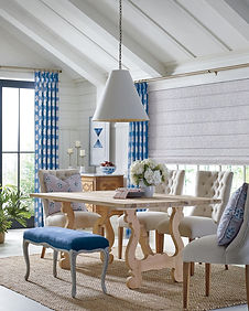 Hunter Douglas Design Studio Roman Shades with custom blue window draperies
