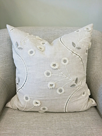 Embroidered linen throw pillow with 3D floral motif
