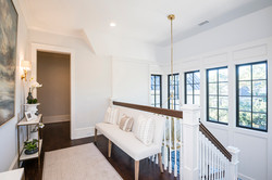 Upstairs landing with modern coastal furniture and accents by Aubergine Home Collection