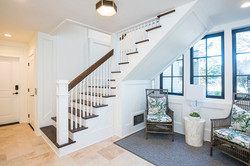 Ground floor entry way sitting area in modern Arts and Crafts coastal home