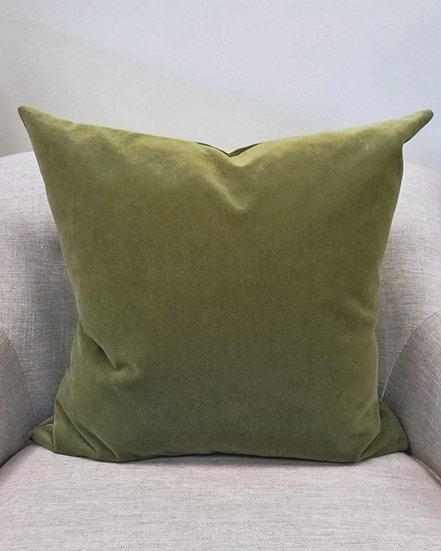 Solid olive green velvet throw pillows with a knife edge finish