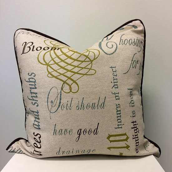 18 and 22 inch square throw pillows in a scrollwork and script print