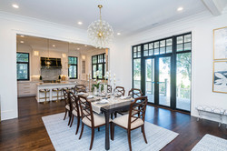 Dining room overlooking back porch and chef's kitchen