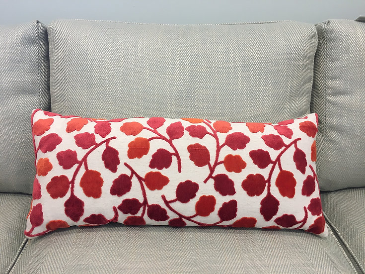 Cut velvet decorative lumbar throw pillow in shades of coral and orange