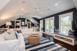 Kiawah Island home's loft space decorated in navy blue and white for a modern nautical look
