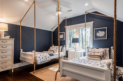 Kid's room decorated in Navy blue and white with nautical accent pieces