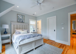 Kiawah Island modern beach house guest bedroom with blue accents