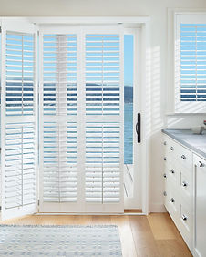 Hunter Douglas Palm Beach Polysatin Shutters on kitchen sliding glass door