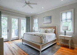 Elegant master bedroom decorated with custom bedding by Aubergine Home Collection
