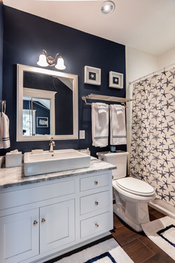 Navy blue and white bathroom with bath accessories and custom starfish shower curtain