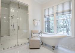 Kiawah Island master bathroom of modern beach house styled by Aubergine Home Collection