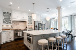 Chef's kitchen with large island and custom cabinetry for an elegant coastal style