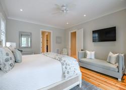 Modern beach house bedroom in neutral tones