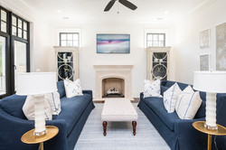 Elegant blue and white living room with custom throw accent pillows by Aubergine Home Collection