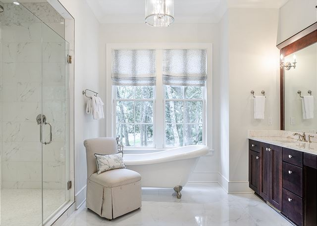 Master bathroom with large soaking tub and glass-enclosed shower