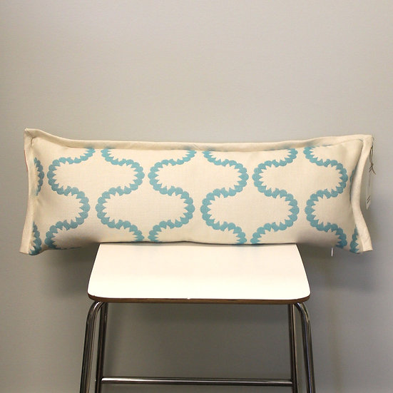 Oblong throw pillow in a turquoise geometric wave pattern