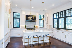 Chef's kitchen with custom upholstered counter barstools by Aubergine Home Collection