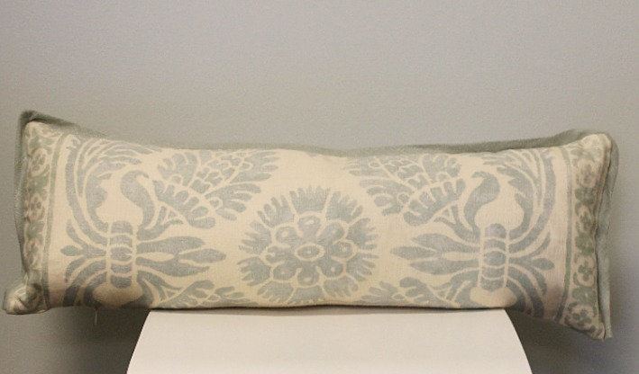 Oblong throw pillow in a powder blue and ivory floral print