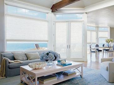 Hunter Douglas Provenance Woven Woods custom window coverings in coastal living room