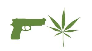 photo of a gun and a marijuana leaf