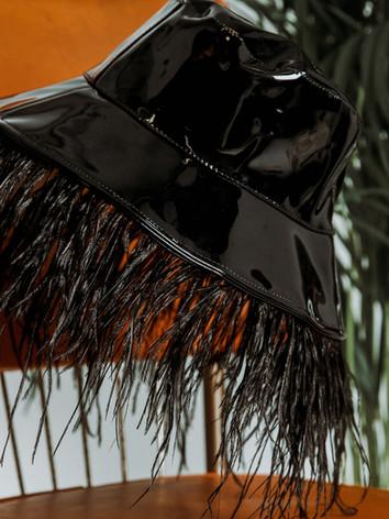 Vinyl feather bucket hat