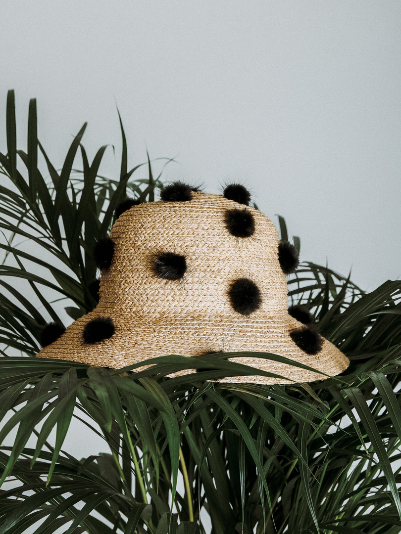 Faux fur ball woven bucket hat