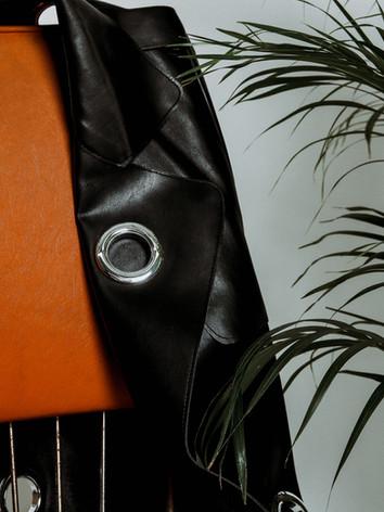 Faux leather eyelet coat