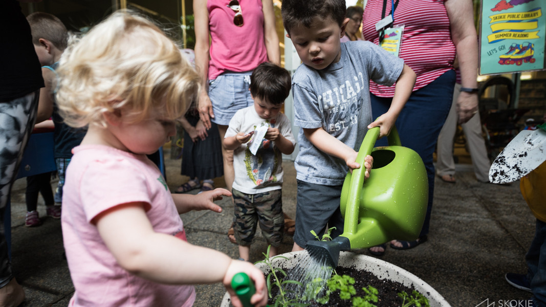 Parents and children explore nature together with ECA partner, SKokie Public Library